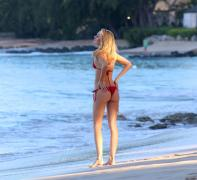 Kimberley Garner in red bikini on the beach